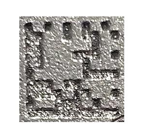 Deep laser engraving of a DMC with dark clock