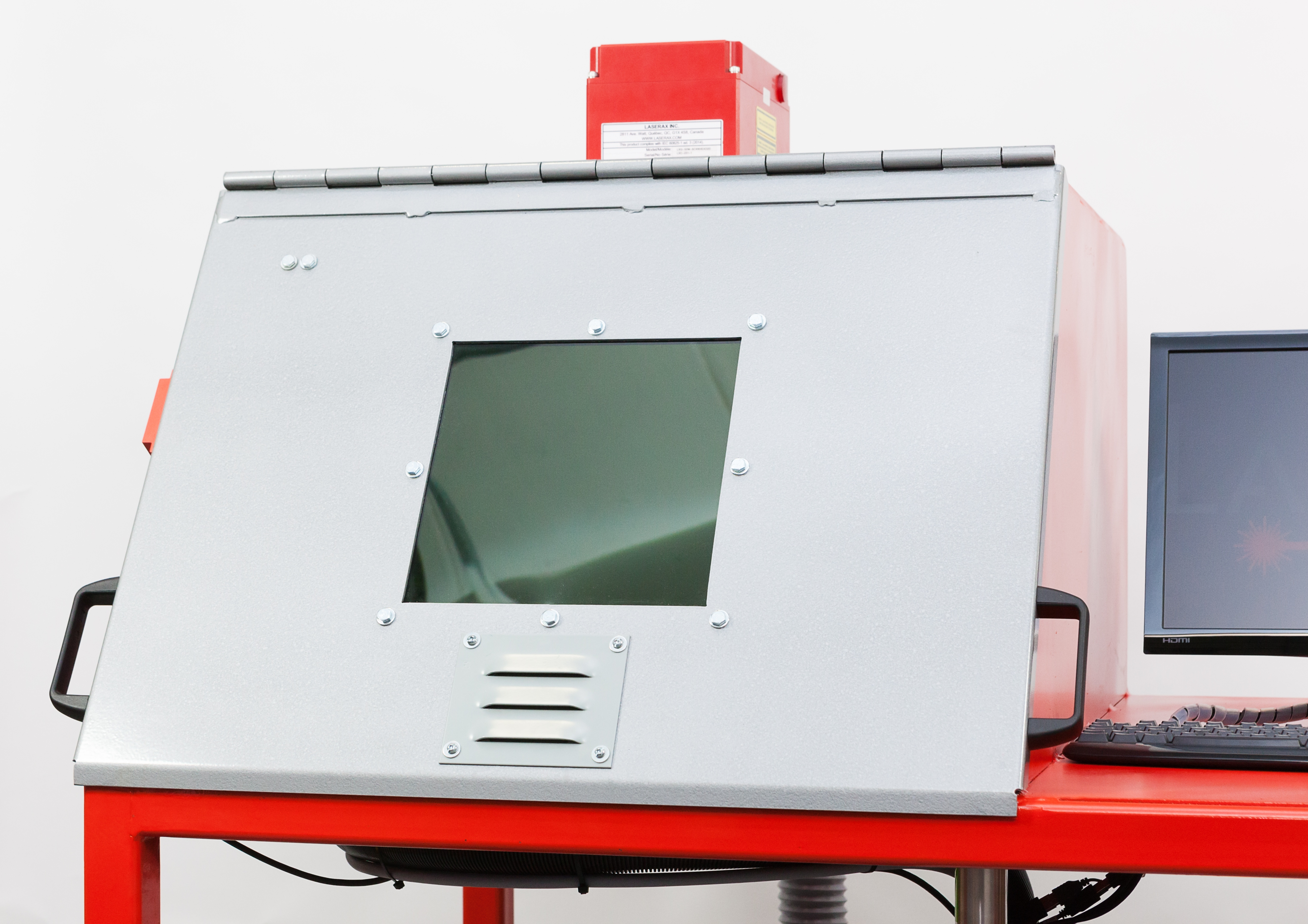 Laser safety enclosure topped by the laser head